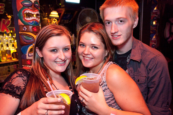 Ashley Carter, Chelsea Cross, and James Schuster gather for good times and a photo opp at Phoenix Hill Tavern on Friday night.