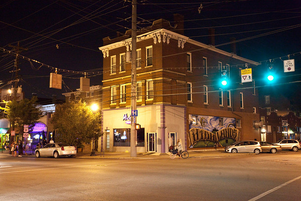 Usually an active intersection on even wintry nights, the heart of the Baxter Avenue bar district found itself a bit quiet after a week of 100+ degree temps.