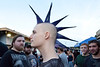 """Cory """"the ManHawk"""" Felker shows off his 'do while fellow friends stand back and marvel at its greatness."""