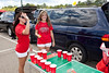 Holly Kaelin and Kayla Chase engage in a game of beer pong with a UofL theme.