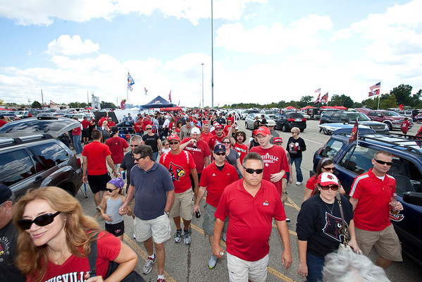 Random scenes and faces in the crowd during UofL Football Tailgating at Papa John's Stadium.