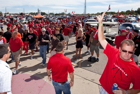 Random scenes and faces in the crowd during tailgating at Papa John's Stadium for UofL vs UNC Football.