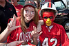 Hannah Thompson and Donovan Wilson have some good times as part of the End Zone Express tailgating party.