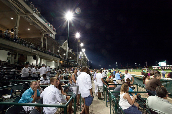 Random scenes and faces in the crowd during Down After Dark at Churchill Downs on Saturday night.