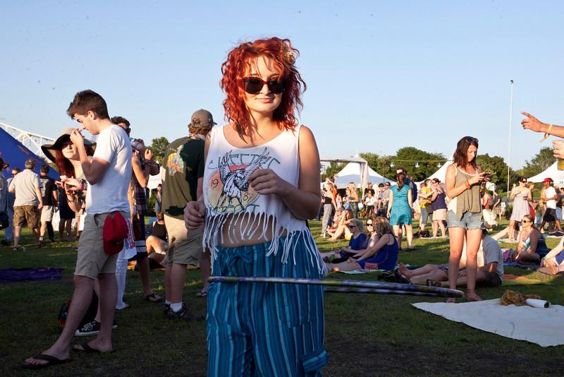 Alexis Dahl hoola-hoops in the setting sun.