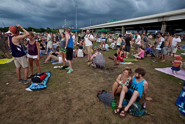Random scenes and various faces in the crowd from a stormy third day at Forecastle Fest 2013 on the Louisville Waterfront.