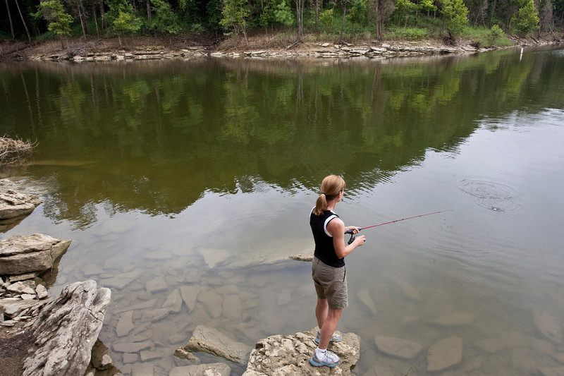 Spencer County resident Sue Balter fishes in a quiet cove near the Possum Ridge Boat Ramp at Taylorsville Lake State Park.