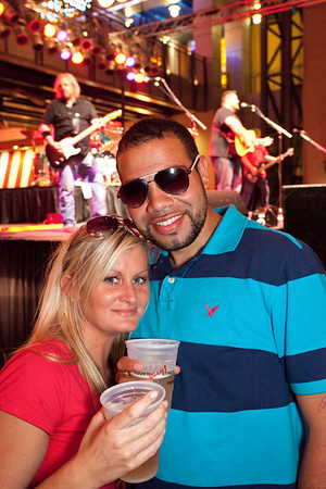 Patrick and Savannah Jenkins find a spot close to the stage during Hot Country Nights at Fourth Street Live on Friday.