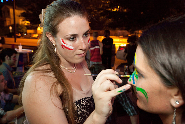 Drummer Kelsey Lee has her face painted by Jackie Royce before the show.