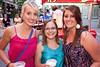 Christina Fleming, Sarah Davis, and Crystal Popp hang out near the backstage area.