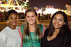 Taylor Gordon, Courtney Palmer, and Lauren Camm hang out near the Midway.