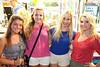 Holly Hoskins, Victoria Hoagland, Jessica Burba, and Heather Hoskins were backlit by the soft glow of a vendor.