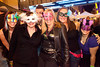 Random scenes and various faces in the crowd at the Mardi Gras Party at Fourth Street Live on Saturday.