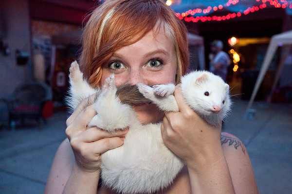 Lexi Love shows off her partner, Tundra the Ferret, from the freestyle category of a beard contest sponsored by the Derby City Whisker Club during Mutiny Fest at The Tim Faulkner Art Gallery on Saturday.