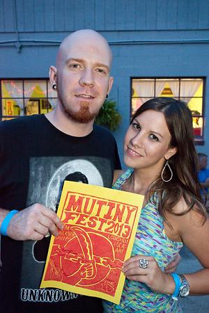 Musician Demi Demaree and poet Melissa Brutscher show off the poster art for Mutiny fest.