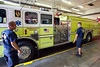 Sergeant Allen Weber and Captain Chris Fries, Jr of the PRP Fire District Station 1 take a closer look at one of the trucks.