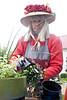 Jacqueline McGrail demonstrates proper planting techniques.