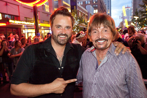 Country music star Randy Houser grabs the pre-show photo opp with legendary Country music deejay Coyote Calhoun.