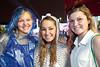 Emma Holbrook, Amanda Morguelan, and Lauren Pickner dodge the rain between races.