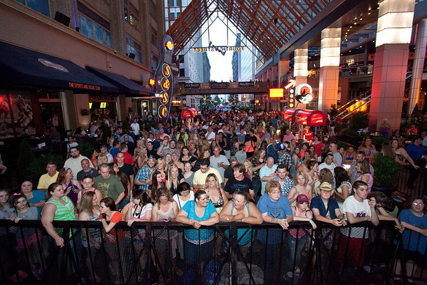 The crowd grew restless for some live country music.