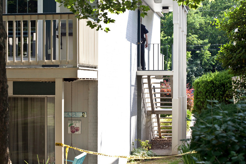 The rear of 1900 Gardiner Lane is secured as police investigate and gather details.