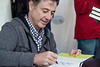 UofL Mens Basketball coach Rick Pitino signs copies of his most recent book.