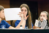 Twenhofel Middle School contestants Aaron Anderson, Emily Girard and Brooke Jones contemplate their response.