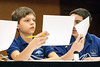 Twenhofel Middle School teammates Aaron Anderson and Christopher Hellmann consider options for the correct reply.