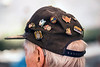 The variety of pins on WWII veteran Daniel McHugh's hat tell the tale of his wartime experiences.