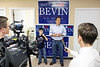 Standing with his son Isaac, Republican Senate candidate Matt Bevin addresses the media and his staff on the eve of the election at his Middletown headquarters.