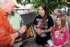 Rachel and Emma Cromer of Knoxville, TN are thrilled as Beach Boys frontman Mike Love autographs an album for them.