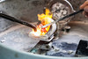 A variety of metals are melted down as part of the process of lost wax casting.