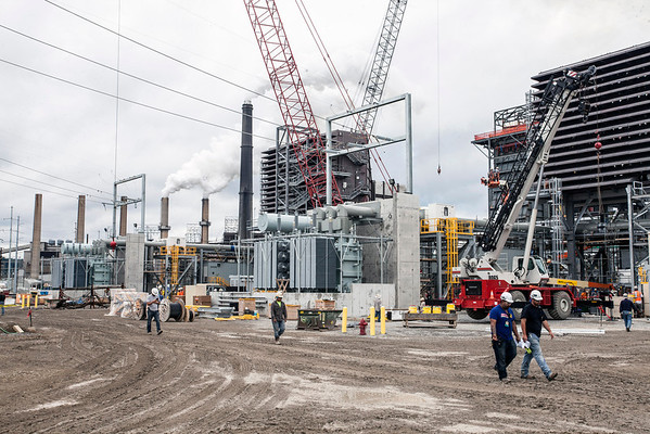 With the LG&E coal plant looming in the distance, and fully fired up, construction continues on a more eco-friendly natural gas plant. Once operational, the gas plant will handle the area demands and the coal plant will be retired after a life of service that began in 1953.