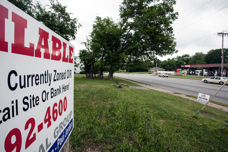 """A real estate sign at the corner of Preston Highway and East Manslick Road foreshadows possible changes to the area with the wording """"currently zoned"""" featured."""