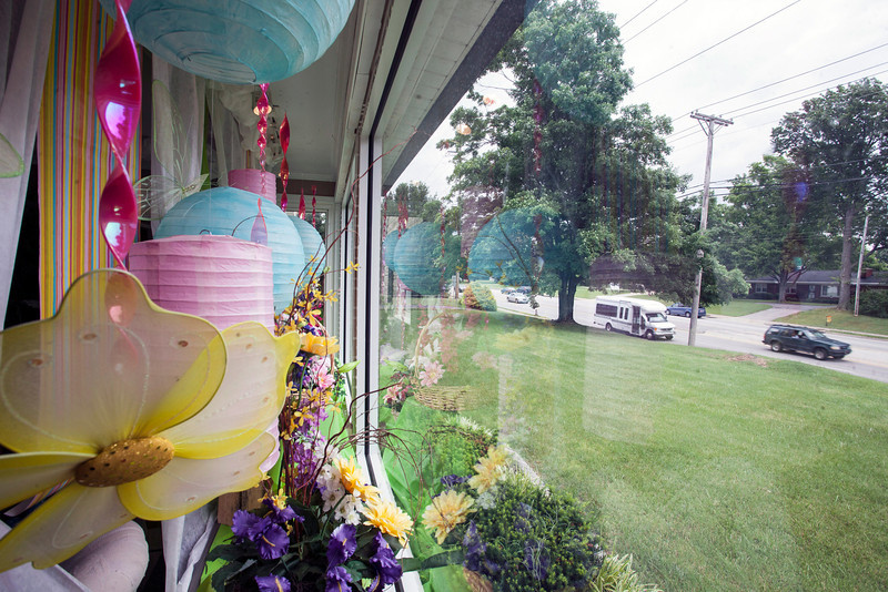 The view from the front window of Lloyd's Florist shows a busy stretch of Preston Highway running  through a mostly residential area.