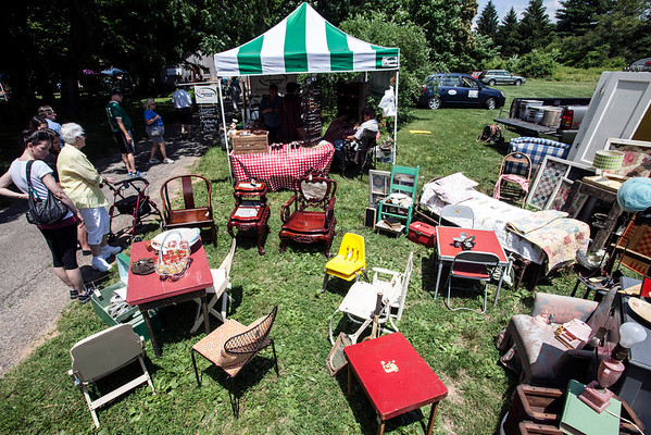 """Antiques and Uniques"" was the theme of a well-attended flea market at Farmington Historic Home on Sunday as families enjoying the weather and Father's Day perused a variety of curios and oddities for sale."