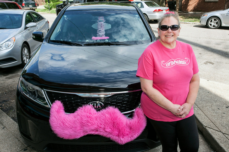 Lyft driver Cindy Weisser shows off the luxury wth a smile that comes from catching a ride with her.