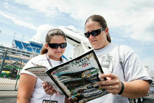 Donna and Allison Coffey of Brodhead, KY reference the Kentucky Speedway program upon arrival.