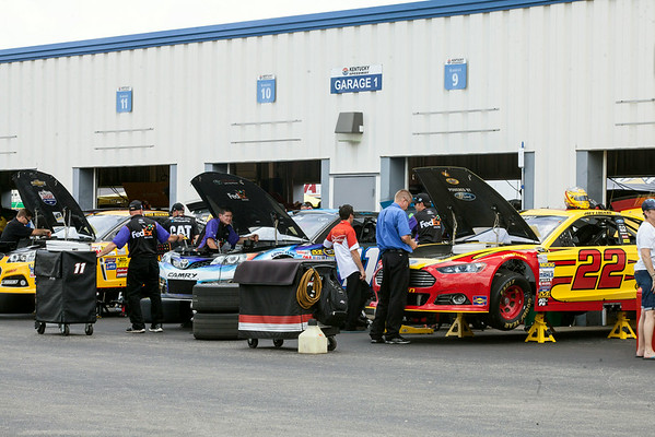 The crews and workers buzzed around the infield's garage areas at Kentucky Motor Speedway in preparation for the weekend's many events.