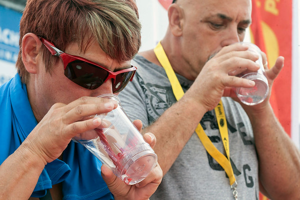Paula Simmons wins the Twizzler challenge as she defeats other contestants by drinking water through a Twizzler the fastest.