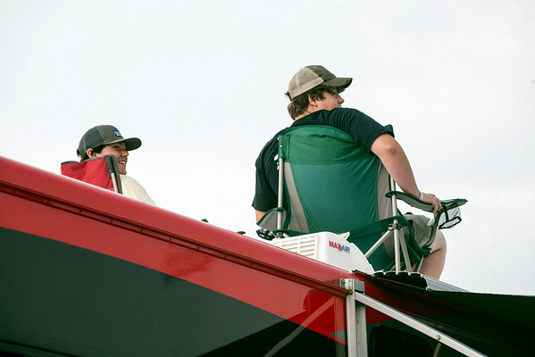 A few young fans in the infield take to the top of an RV for a better look.