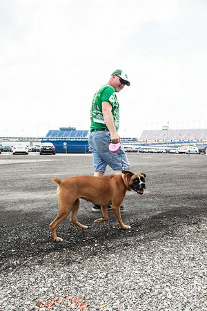 A boxer taking a walk in the infield gives the camera a passing smile.
