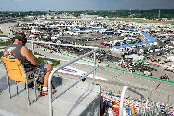A lone fan takes the high perch during an exhibit race.
