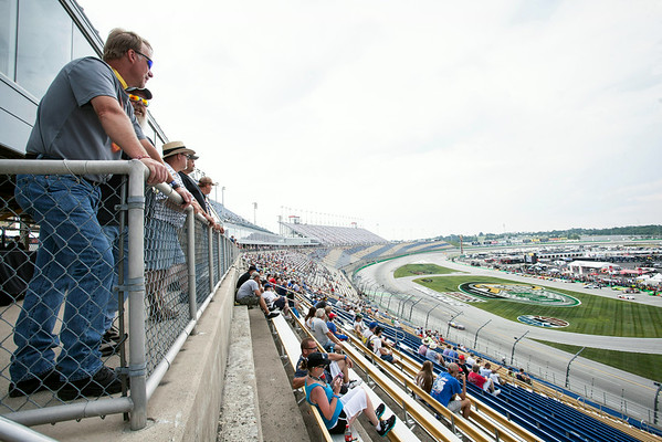 Fans started to trickle in as racers warmed up during an exhibition run.