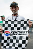 John Lairson shows off his Kentucky Speedway flag complete with the autographs of 10 NASCAR drivers and Miss Kentucky 2014.
