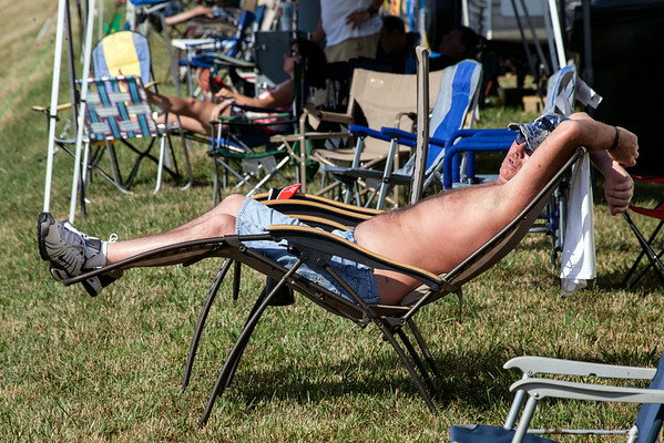 Despite the noise and the heat, some were right at home on the outer hillside of the track.