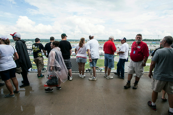 Fans began to emerge from the shelter of the concourse after a torrential downpour roared over Kentucky Speedway.