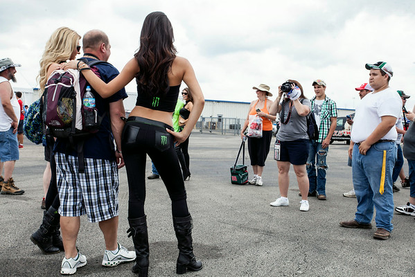 Representatives from Monster Energy Drink worked the Fan Zone on Day 3 of NASCAR action at Kentucky Speedway granting photo opps to happy fans.