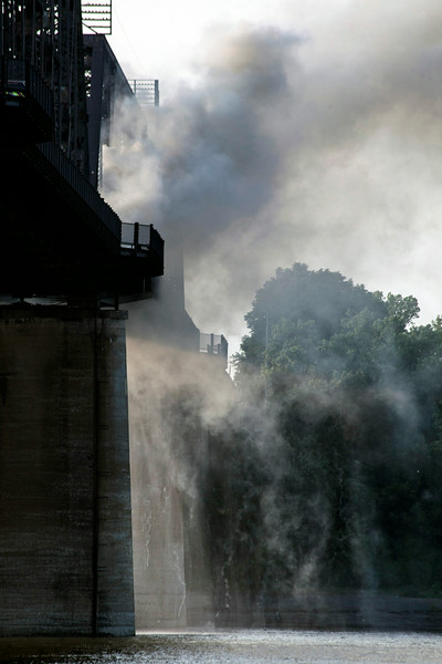Plumes of smoke billowed above the Ohio River as the bridge fire was contained.