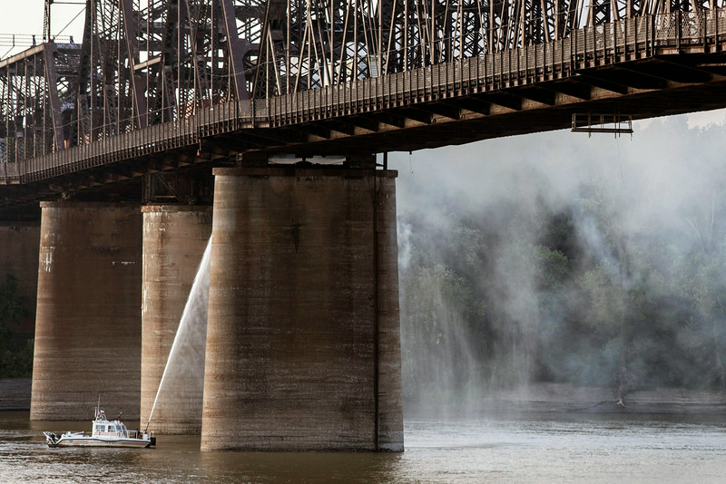 Members of the Louisville Fire & Rescue Marine Unit sprayed water from below in an effort to extinguish the fire.